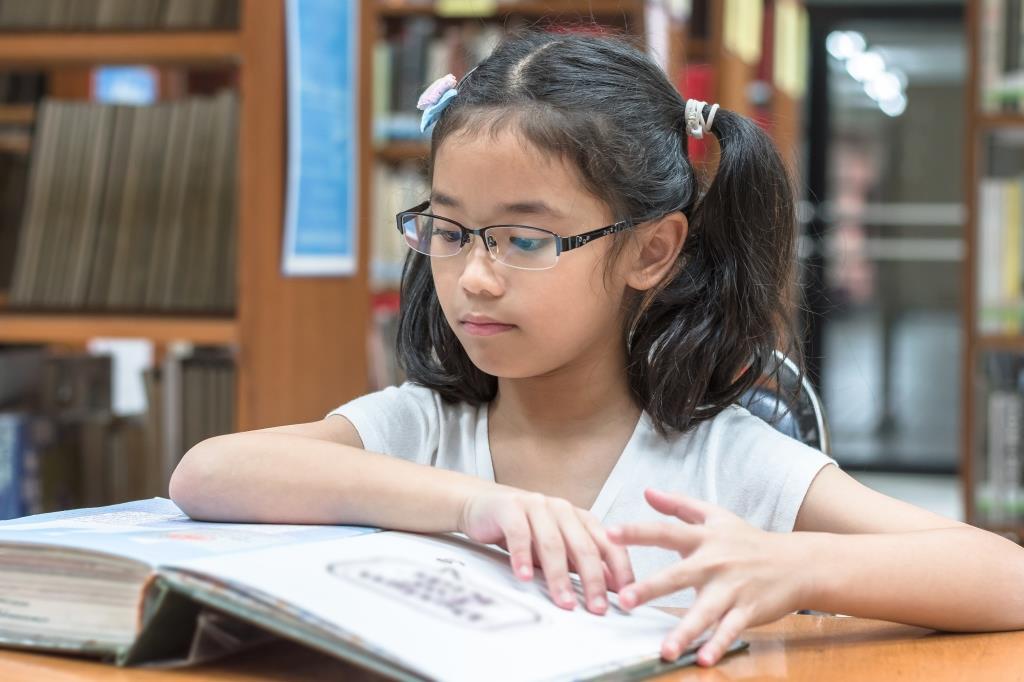 Primary girl studying